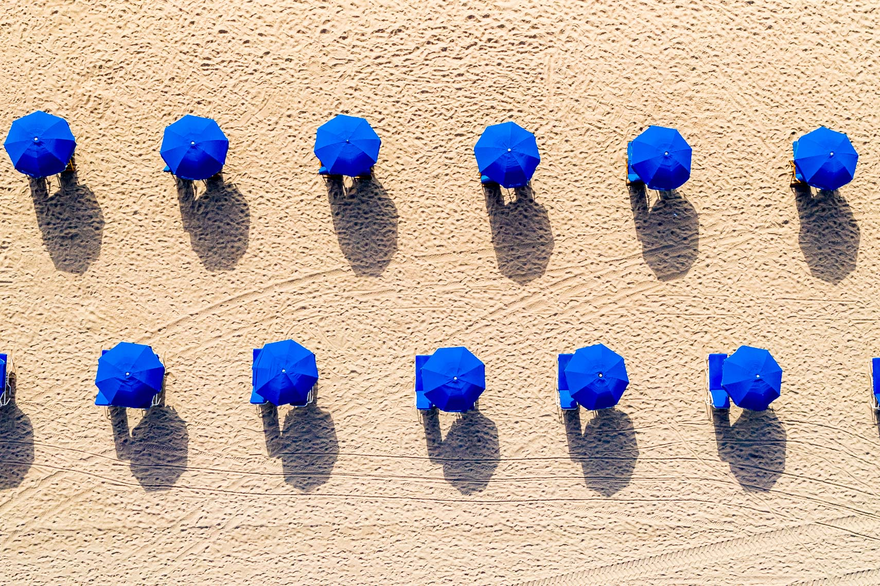 Blue Umbrellas On The Beach