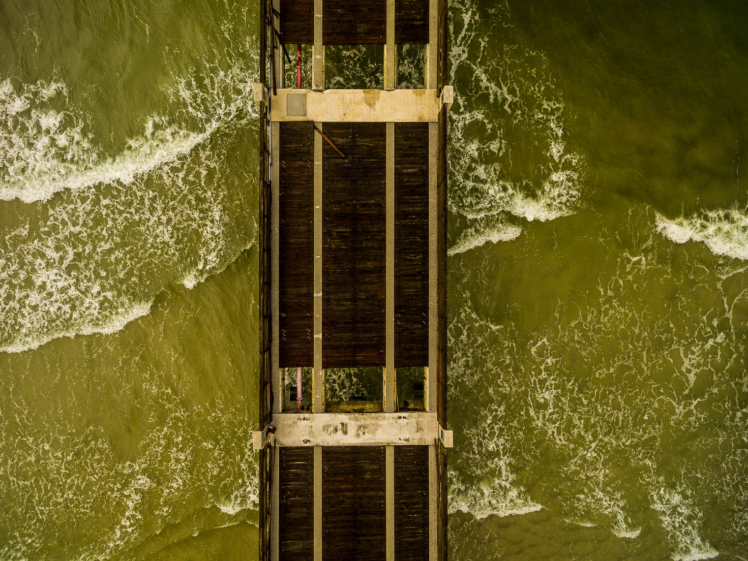 Overhead drone view of the Jacksonville Beach Pier after it was severely damaged by Hurricane Matthew