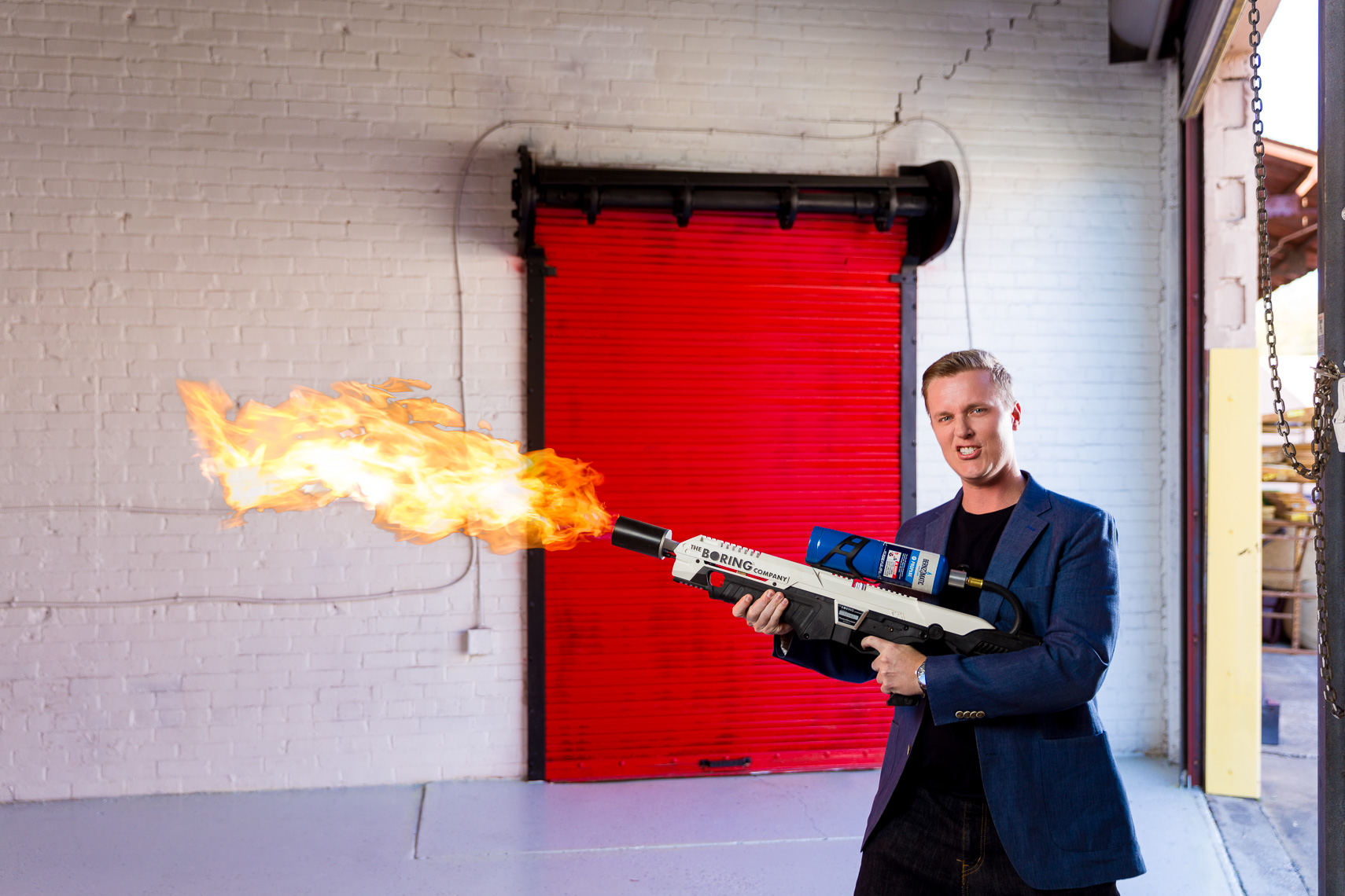 Corporate portraits with a flame thrower and a red door