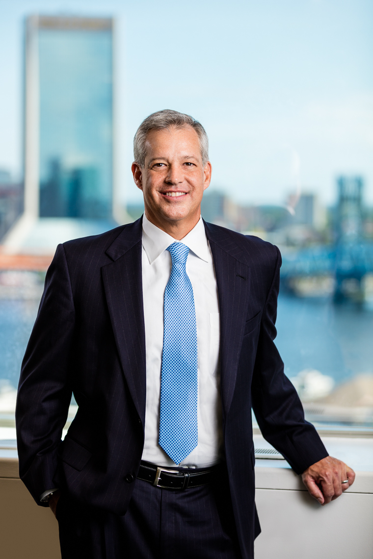 Portrait of an executive with a citscape background