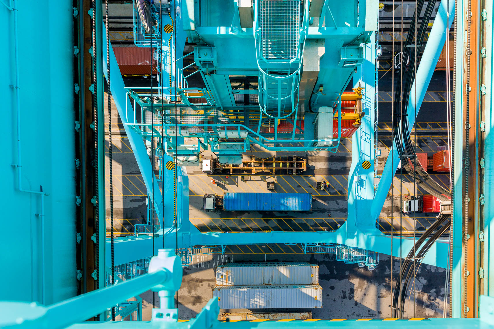 Overhead view of a crane loading containters onto a cargo ship at JAXPORT