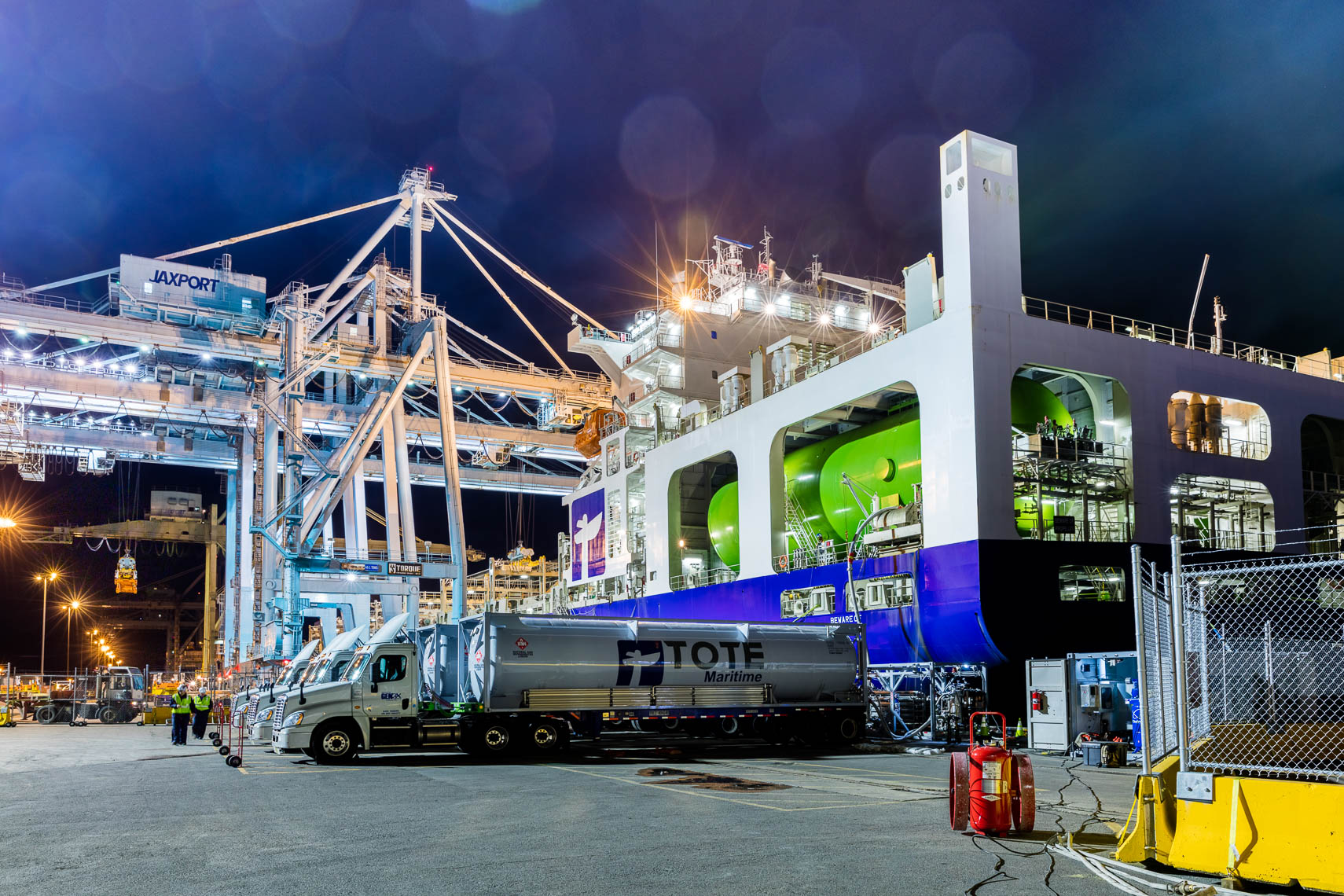 LNG trucks refill the LNG tanks on Tote Maritime