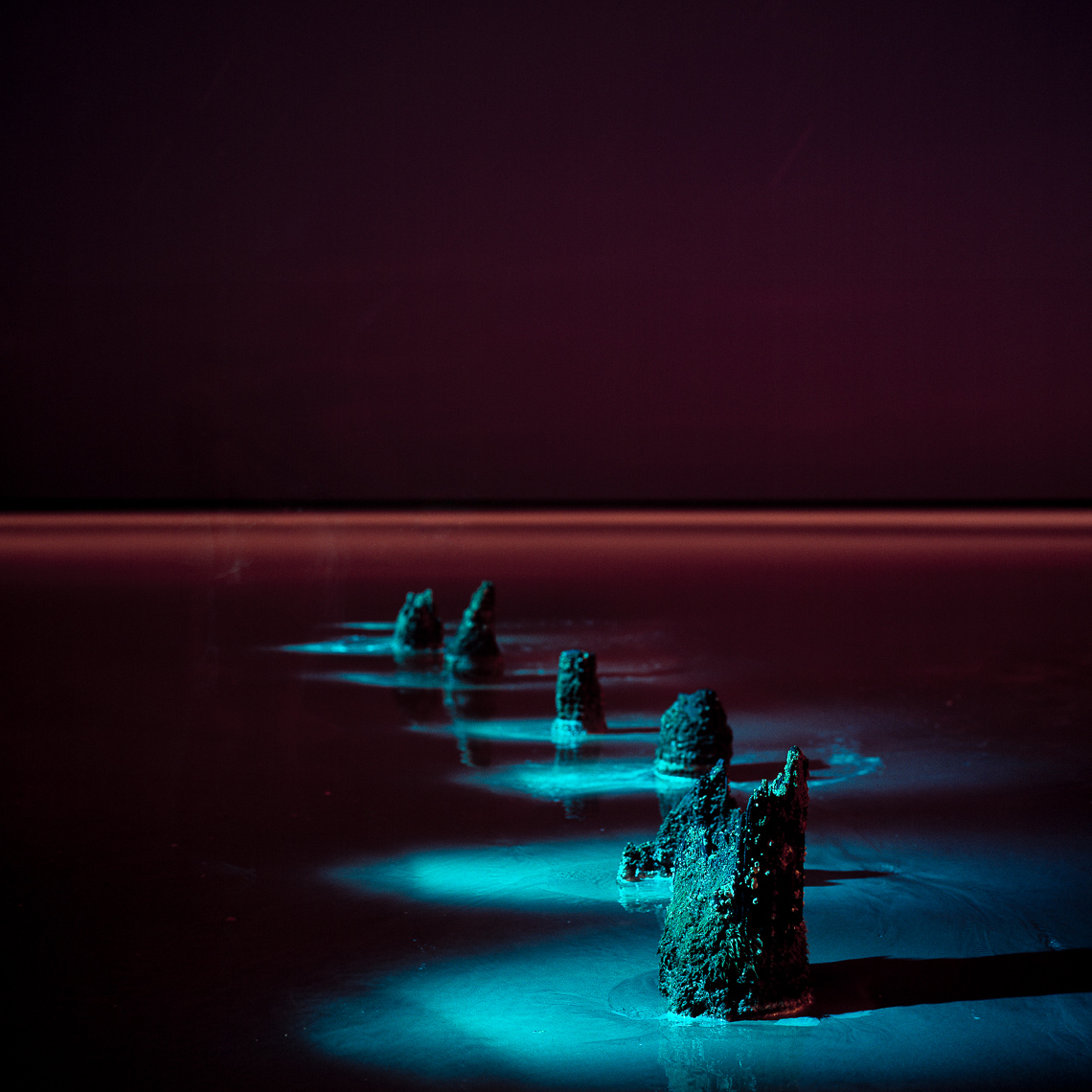 Light painted structures in the water at night