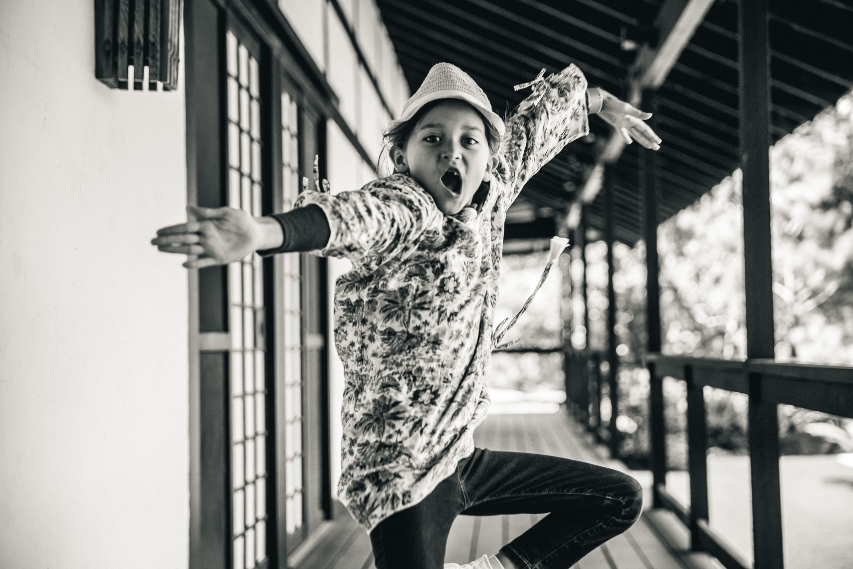 An energetic young kid jumping