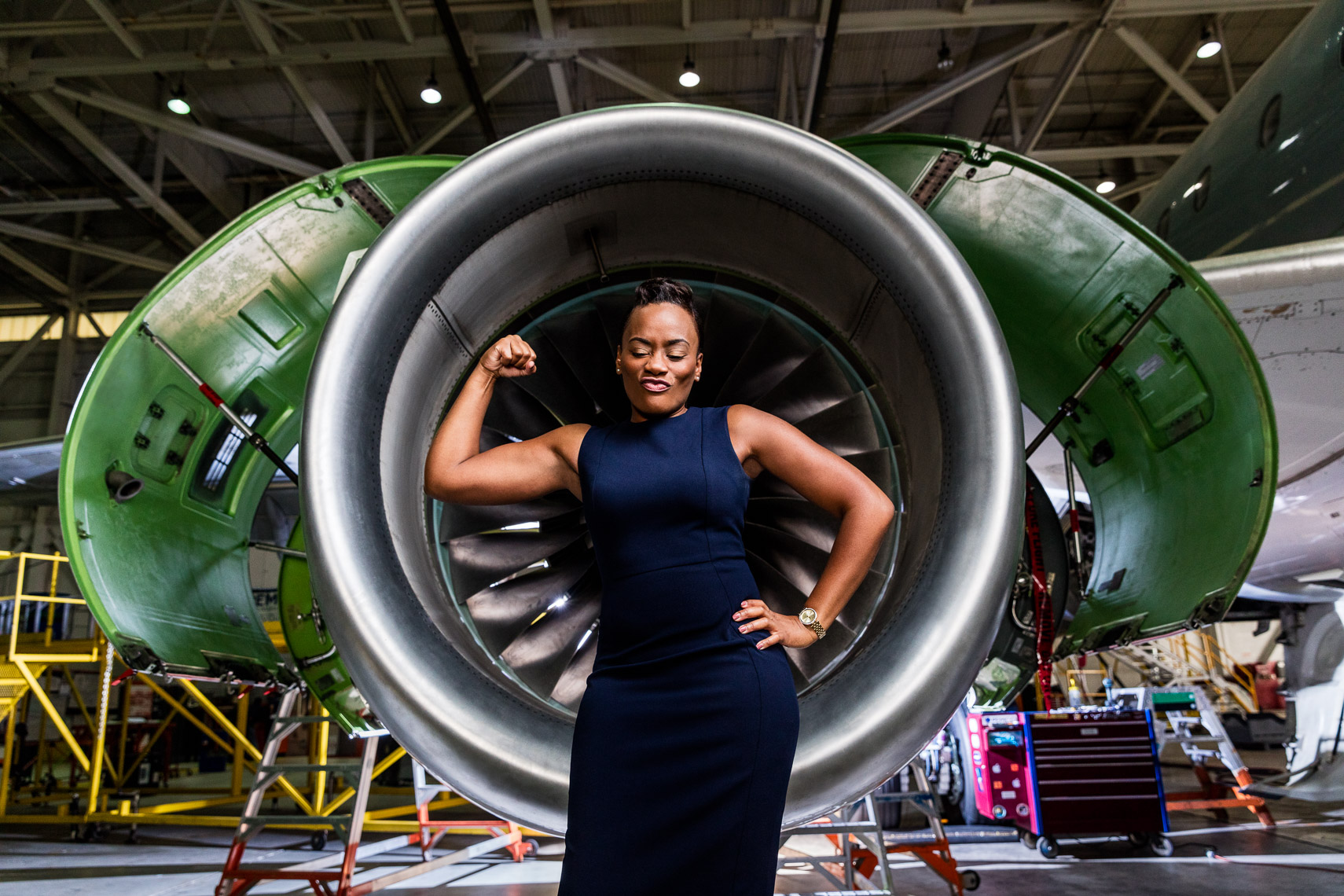 Powerful portrait of a woman in front of a 737 jet engine