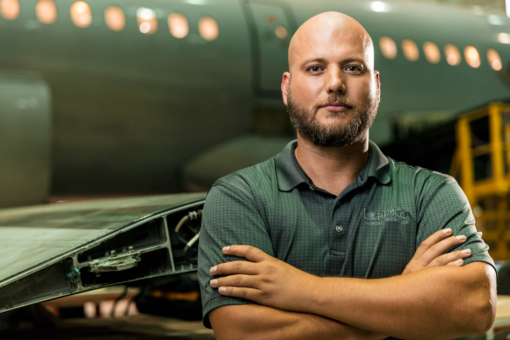 Portrait of a man in front of an airplane